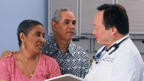 Couple consults with doctor