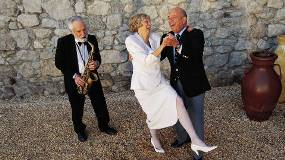 Sax player with husband and wife dancing.