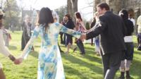 Family dancing and having fun outdoors.
