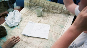 Two people using a map to plan.