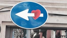 Sign with a arrow through a heart.