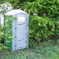 A port-a-potty which is convenient but still crappy