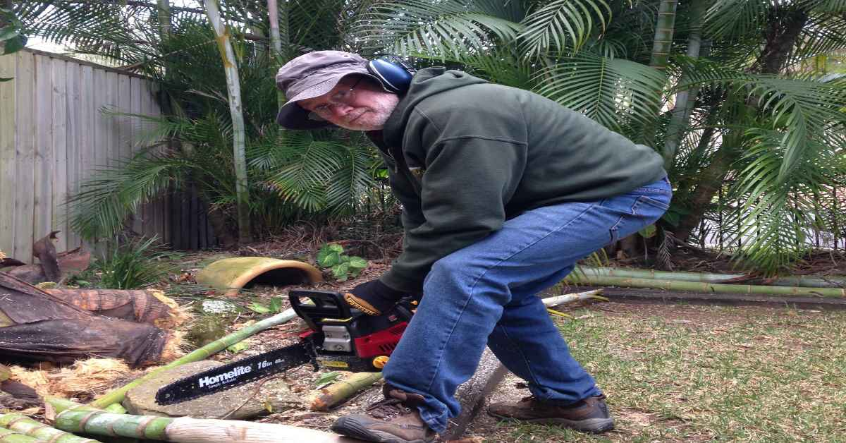 Man with Alzheimer's using a chain saw