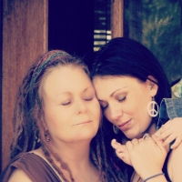 Mother and Daughter Embracing due to the emotional impact of Alzheimer's