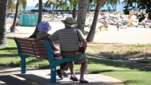 Alzheimer's care partners sitting and watching the sites at the beach