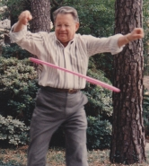 Older man using a hula hoop