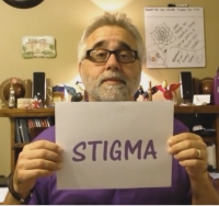Brian LeBlanc holding card that says Stigma