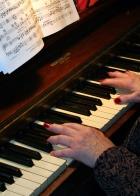 Lady playing a piano
