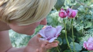 Woman with dementia smelling a flower
