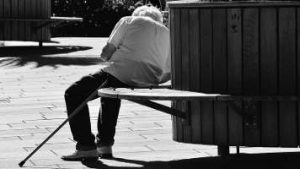 Man with dementia sleeping on bench