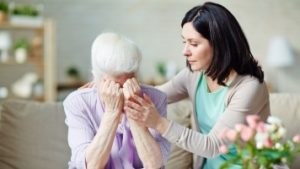 A Daughter Comforting Her Crying Mother who has Dementia